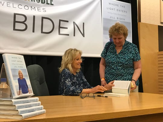 "Dr. Jill Biden signs a copy of her new memoir, ""Where the Light Enters,"" for Baltimore resident Elaine Crock Saturday at Barnes & Noble near Wilmington. (Correction: An earlier version of this story misidentified the Baltimore resident in this photo. It has been corrected.)"