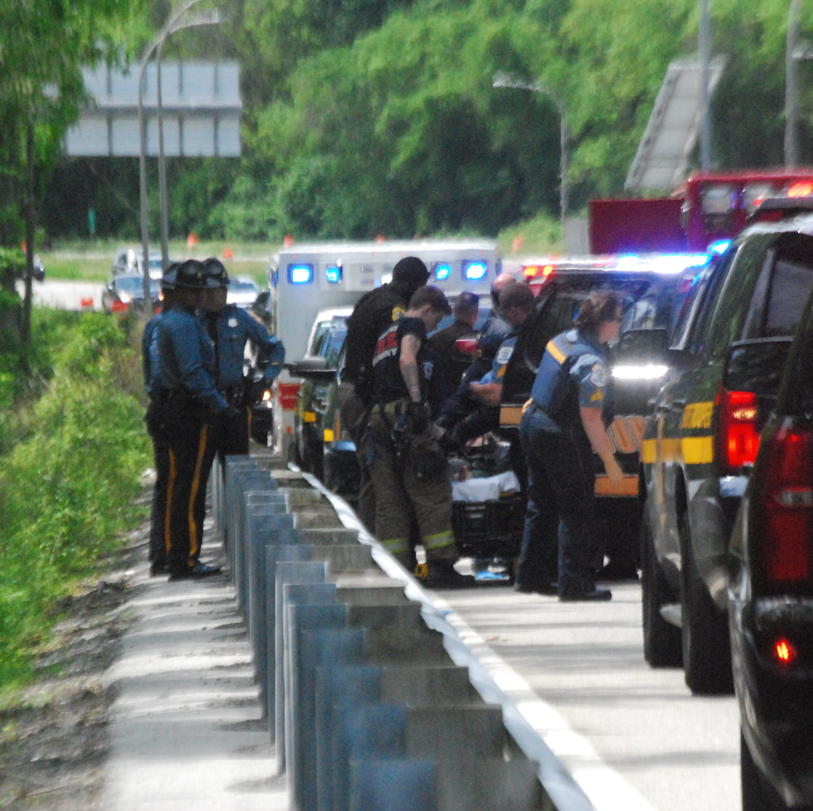 New Castle County officer stabbed on I-95 off-ramp after foot chase
