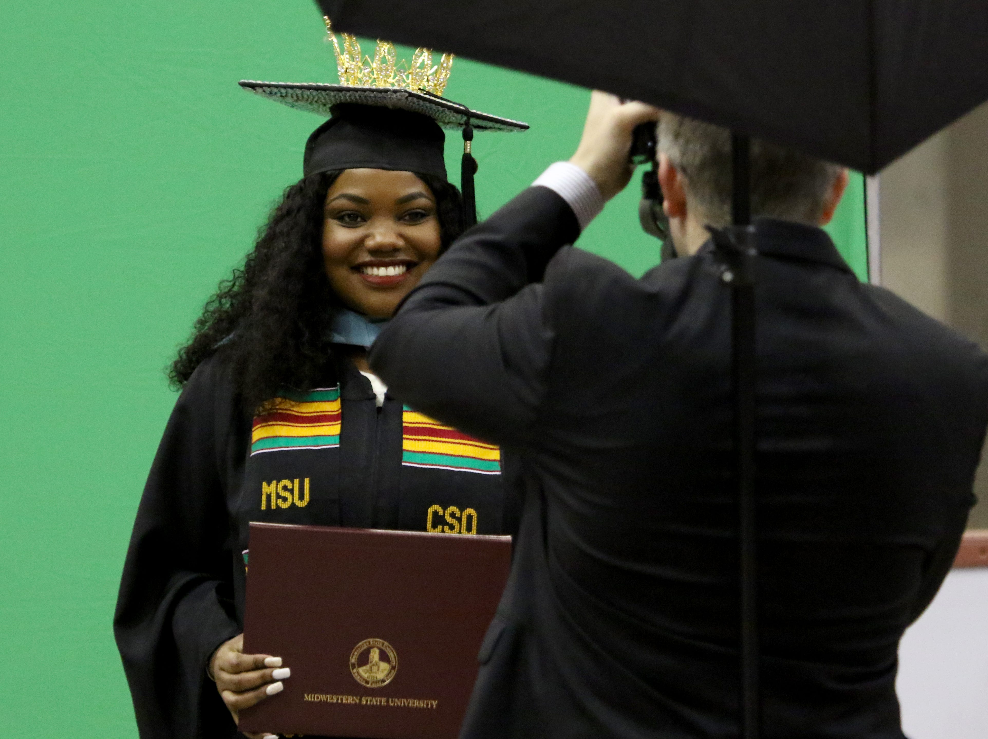 Graduates have their photo taken after walking across the stage at Midwestern State University's Spring Commencement Saturday, May 11, 2019, in Kay Yeager Coliseum.