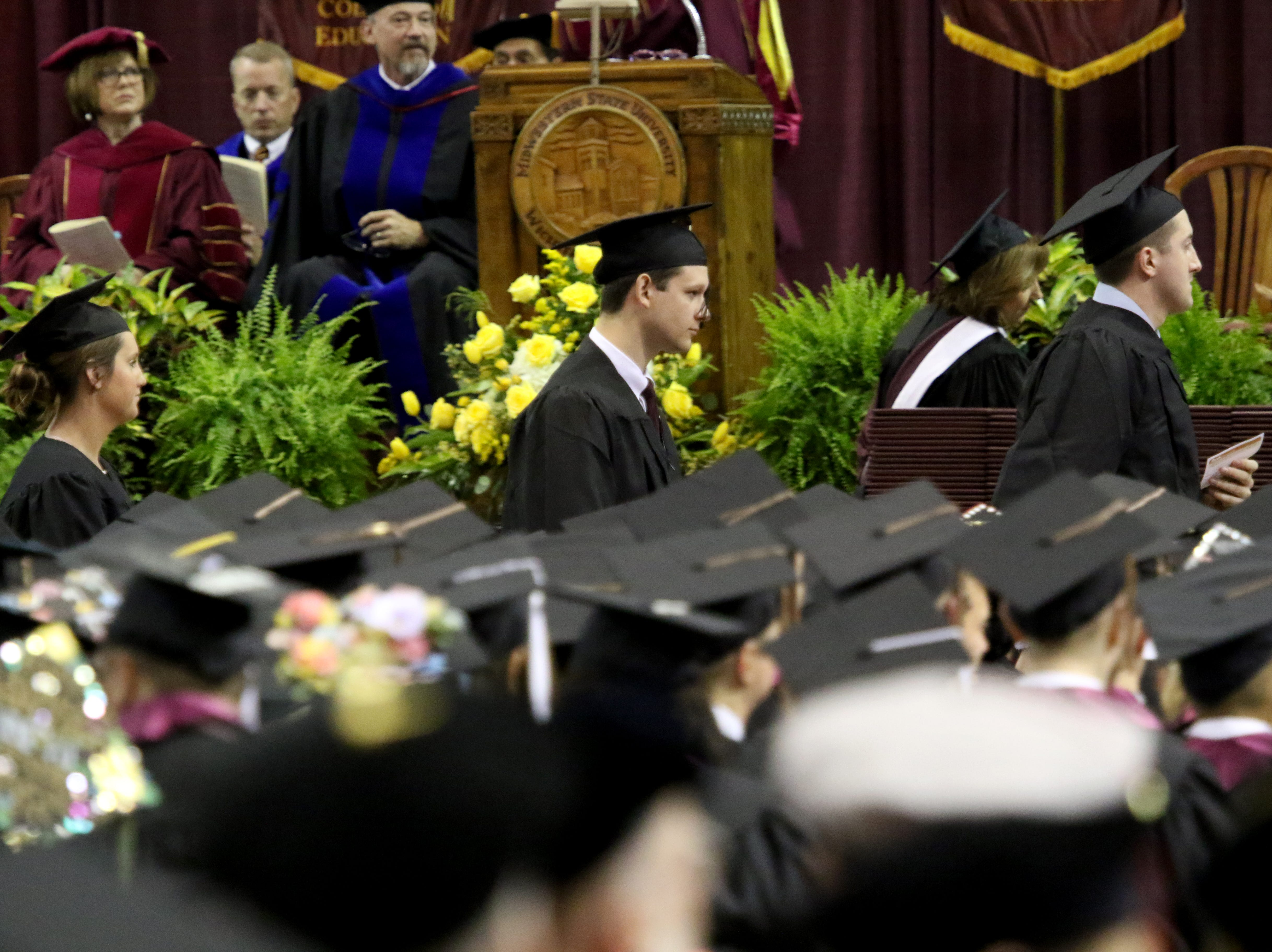 Masters degree graduates line up to walk across the stage at Midwestern State University's Spring Commencement Saturday, May 11, 2019, in Kay Yeager Coliseum.