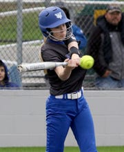 Windthorst's Grace Hoegger hits a single against Stamford Friday, May 10, 2019, in Iowa Park.