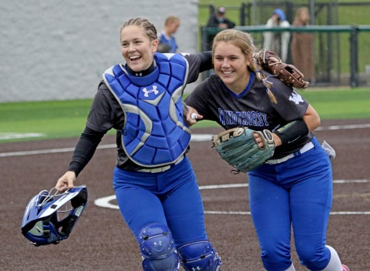 Windthorst's Abby Brown, left, and Laynie Brown head back to the dugout in Game 1 against Stamford Friday, May 10, 2019, in Iowa Park.