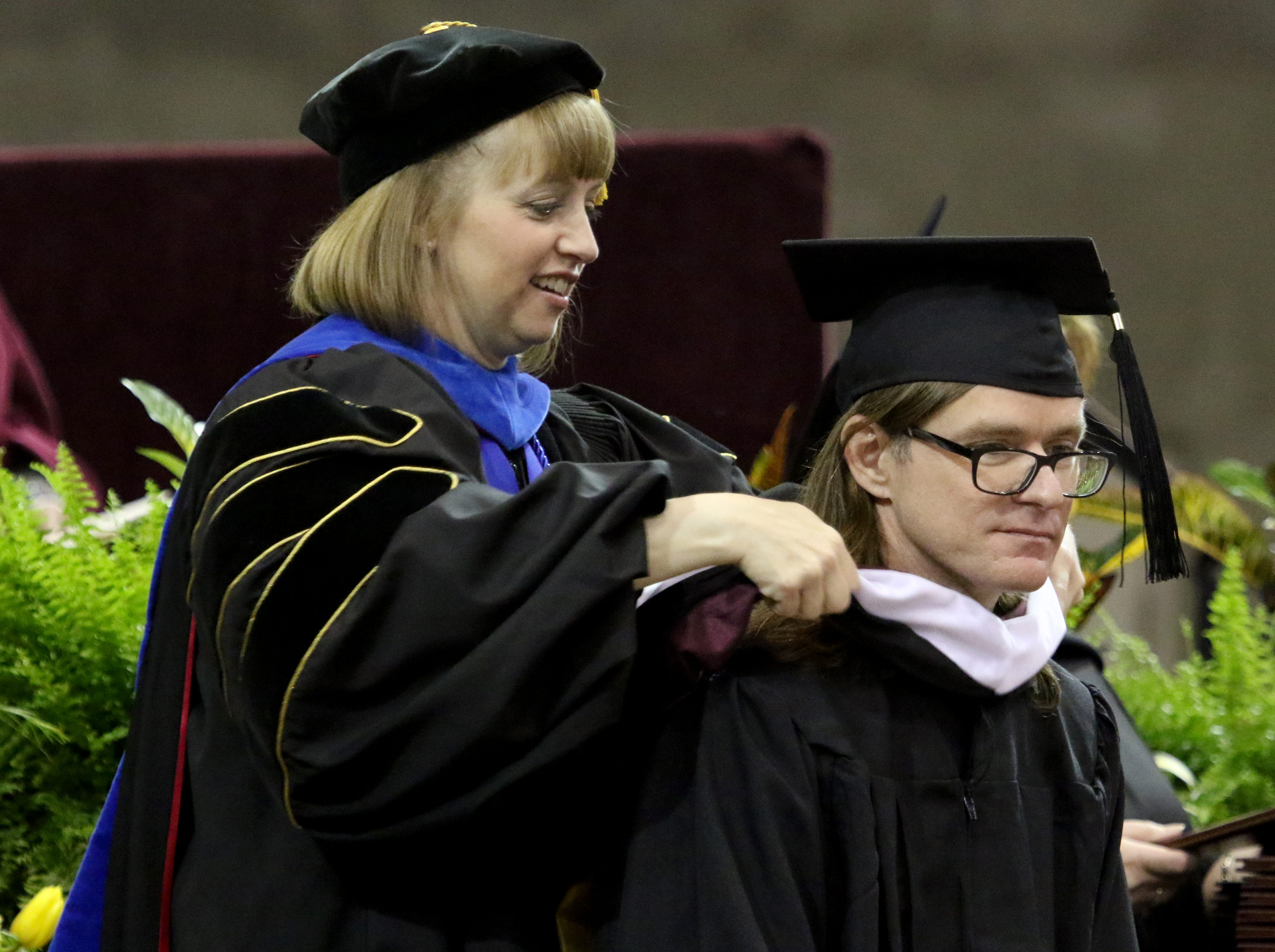 Masters degree graduates are hooded at Midwestern State University's Spring Commencement Saturday, May 11, 2019, in Kay Yeager Coliseum.