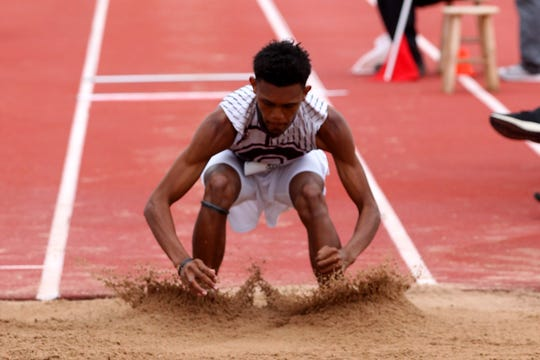 Seymour's Casean Warren jumps in the 2A boys triple jump to a third place finish