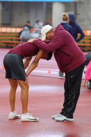 Vernon's Anthony Garza is consoled by coach Lee schur after after failing to clear 6-9 in the 4A boys high jump on Day 2 of the UIL State Field & Track Championship in Austin..