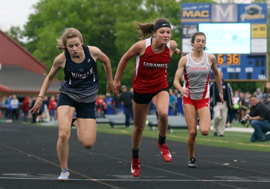 Morgan's Josie Knierim, left, and Crooksville's Greta Barker finish one and two in the 100 meter dash finals during the MVL meet on Friday.