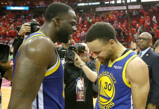 May 10: Draymond Green and Steph Curry celebrate after the Warriors finished off the Rockets in Game 6 to advance to the Western Conference finals.