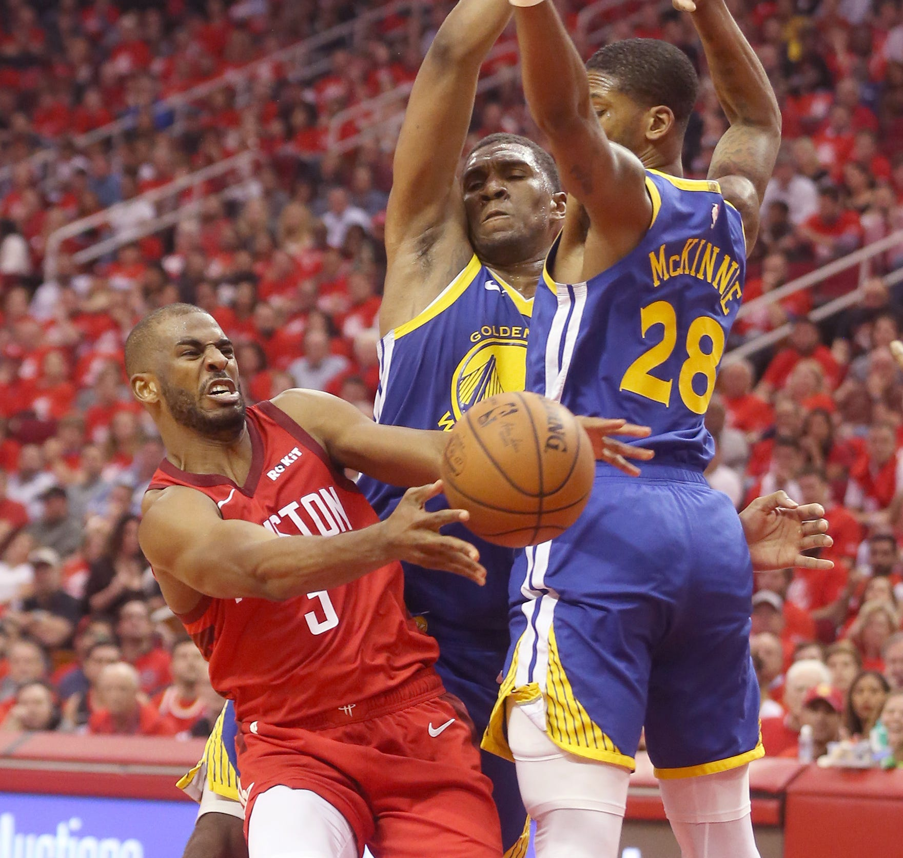 May 10: Rockets guard Chris Paul (3) tries to pass around Warriors defenders Alfonzo McKinnie (28) and Kevon Looney (23) during Game 6 against the Warriors.