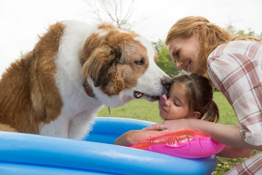 """Buddy (voiced by Josh Gad) climbs in with toddler CJ (Emma Volk) for an affectionate lick as Hannah (Marg Helgenberger) looks on in """"A Dog's Journey."""""""