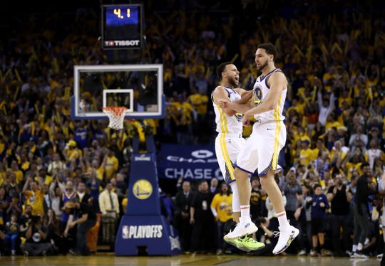 Stephen Curry and Klay Thompson celebrate during Game 5 against the Houston Rockets.