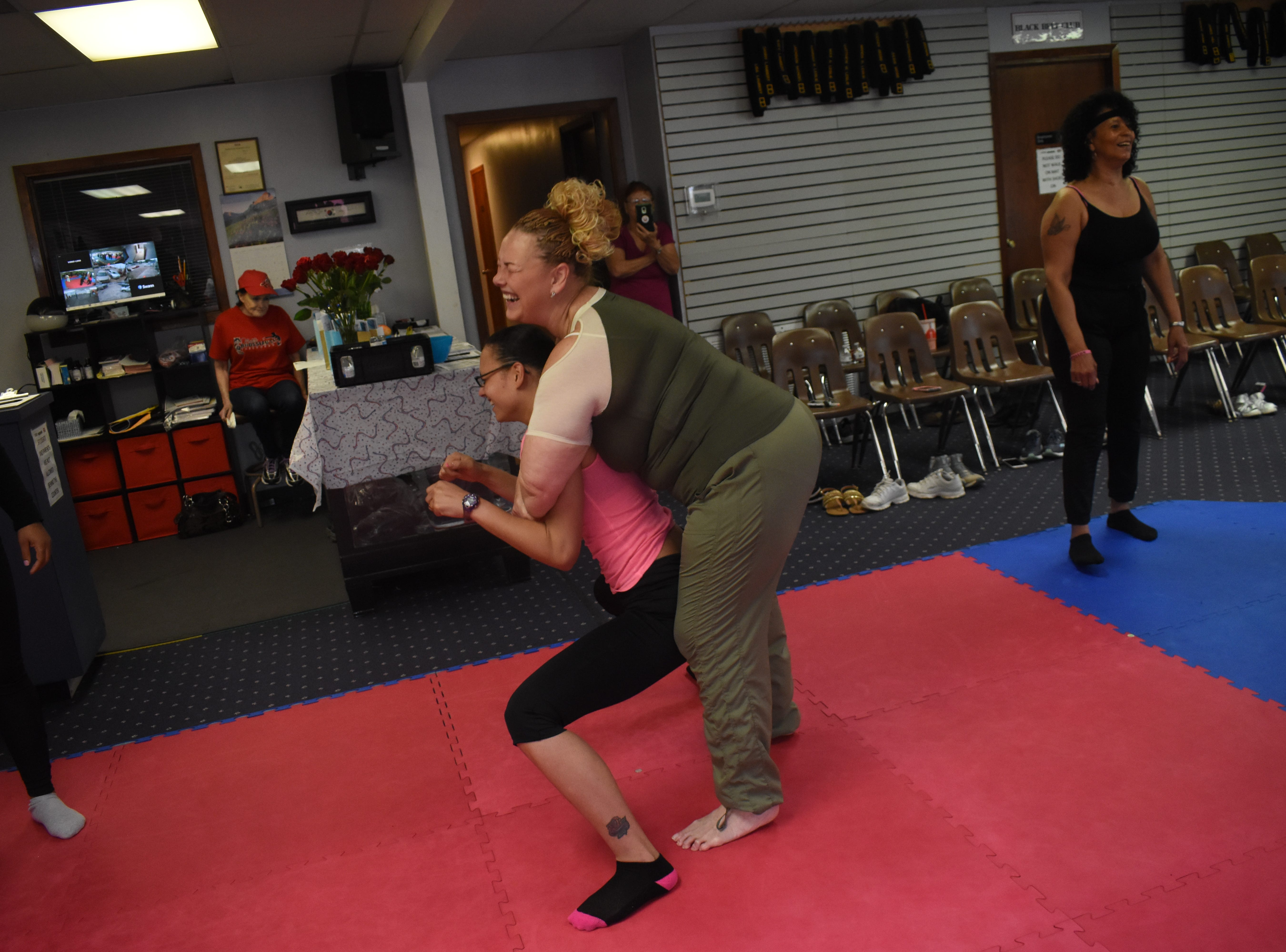 """Carol Rousseau, owner of Master Rousseau's Taekwondo, and a few of her instructors conducted a free women's self-defense workshop held for women Saturday for Mother's Day. Rousseau has been holding a yearly Mother's Day self-defense workshop since 2015. """"Everybody learned the basics,"""" said Rousseau, such as how to use their elbows, knees, how to kick and how to use the heels of their palms. """"They learned how to get out of chokeholds, bearhugs,"""" she said. """"They learned how to get out of headlocks."""" She wanted everyone to have a good time and learn some basic self-defense techniques. """"I hope they never get attacked,"""" said Rousseau. """"But if they do, they can at least know how to get out of it."""" Master Rousseau's offers at 6:45 p.m. self-defense classes on Monday and Wednesdays. For more information, call (318) 443-8066."""