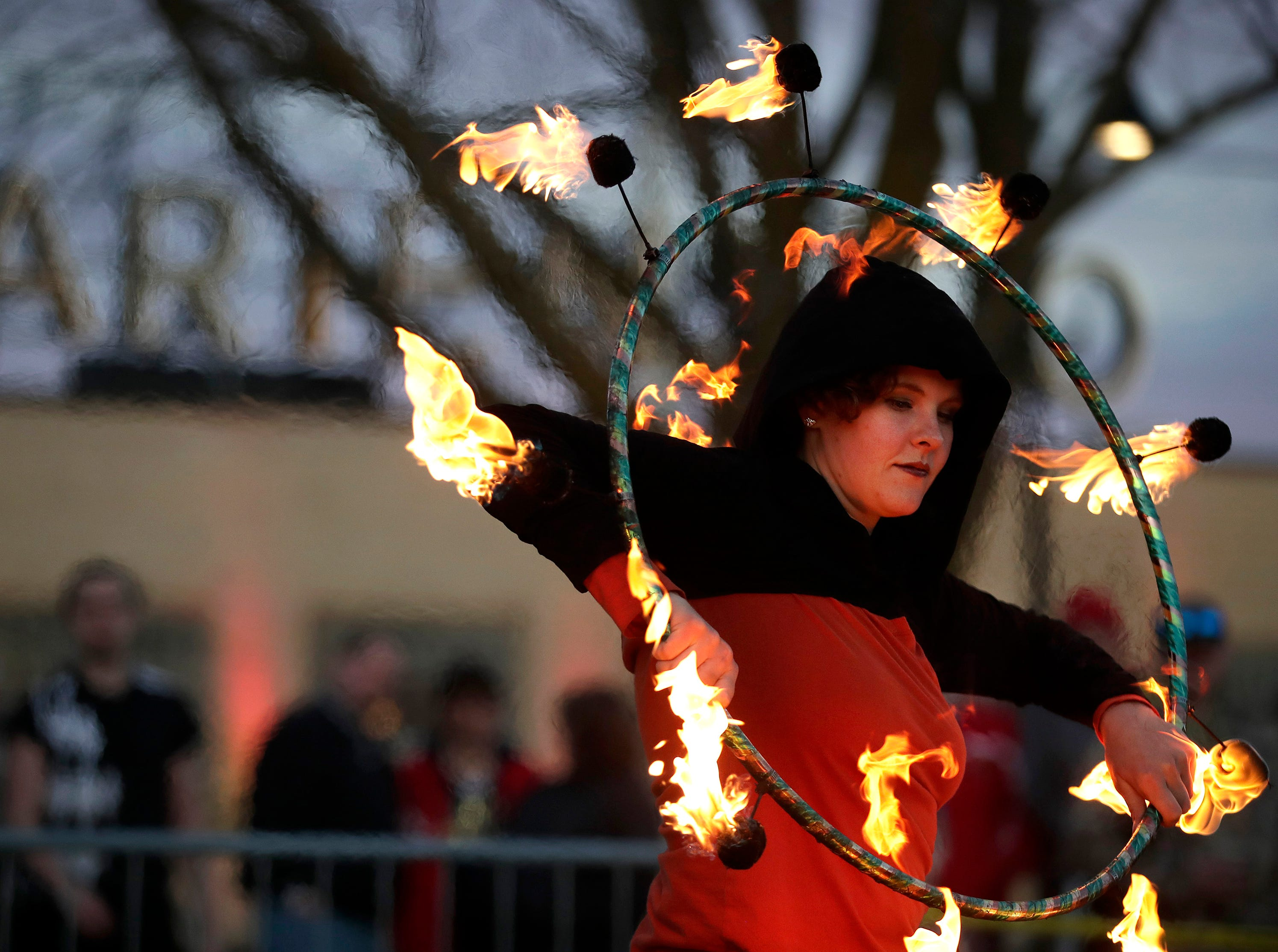 Anna Krueger, with with Fox Valley Fire and Flow Collective, performs in front of the Ariens Co Museum during Bazaar After Dark Saturday, May 11, 2019, in Brillion, Wis. Danny Damiani/USA TODAY NETWORK-Wisconsin