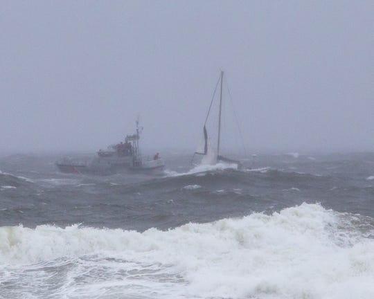 A Coast Guard vessel helps a stranded sailboat off Bradley Beach.