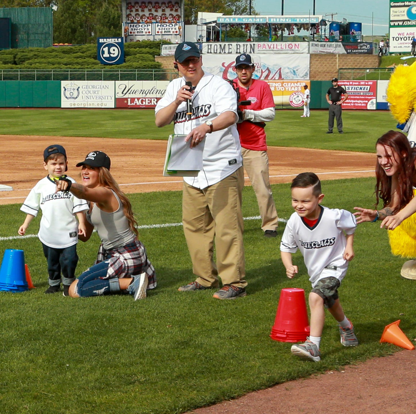 Watch NJ Marine, home from overseas, surprise his kids at baseball game
