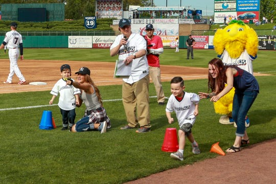The Lakewood BlueClaws welcomed home Lance Corporal Robert Alterisio of Jackson, who surprised his two sons, Robbie and Breyden at the BlueClaws game at the end of the second inning on May 11, 2019.
