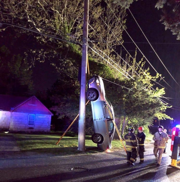 Brick crash leaves car vertical