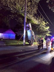 A car ended upright against a utility pole on Manor Drive in Brick on May 11, 2019.