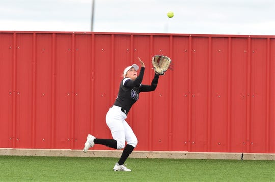 Wylie centerfielder Lilly New (16) tracks a fly ball against Lubbock Coronado in Game 2 of the 2019 Region I-5A quarterfinal. New was a three-year starter for the Lady Bulldogs and manned the leadoff spot in the batting order. She will attend the University of North Texas in the fall.