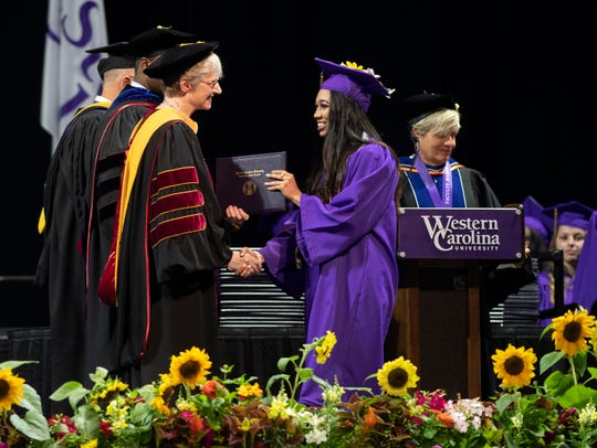A graduating student receives her diploma from WCU Interim Chancellor Alison Morrison-Shetlar.