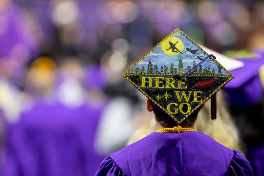 A graduating student expresses his excitement about the future on his mortar board.