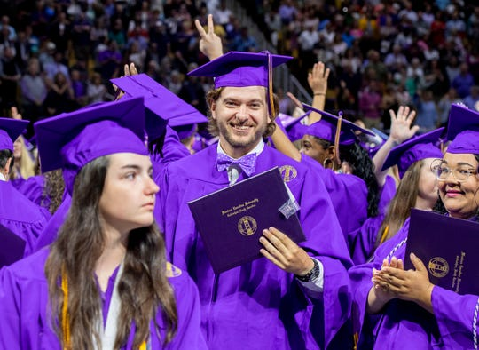 Smiles are in abundance as WCU's new graduates file out of the Ramsey Center.