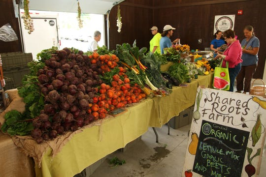 Shared Roots Farm displays produce for sale at the Broome County Regional Farmers Market in 2016.