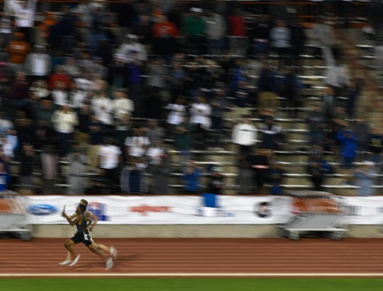 Houston's Strake Jesuit's Matthew Boling begins to pass DeSoto during the men's 4x400 relay during the UIL State Track and Field meet, Saturday, May 11, 2019, in Austin. Boling ran 44.75 during his leg.