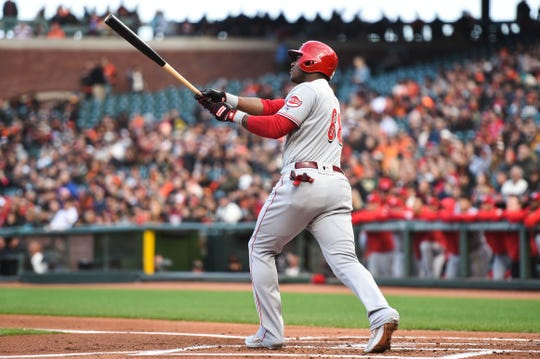 Cincinnati Reds right fielder Yasiel Puig (66) hits a two run home run in the first inning against the San Francisco Giants at Oracle Park.