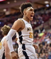 Jeremiah Davenport was the Division I boys basketball player of the year after leading Moeller to the state championship. Davenport celebrates for Moeller at the State Championship game Saturday, March 24, 2018 at Value City Arena