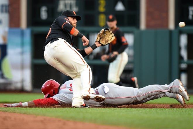 Cincinnati Reds right fielder Yasiel Puig (66) steals second base before San Francisco Giants shortstop Brandon Crawford (35) can receive the throw during the second inning at Oracle Park.
