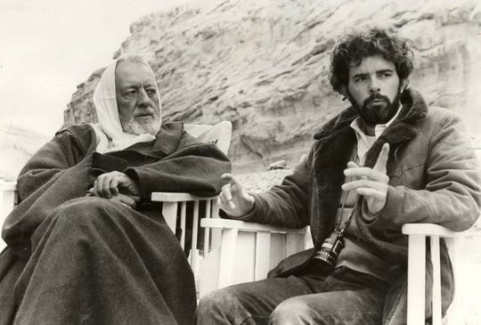 "On the set of ""Star Wars,"" director George Lucas and Alec Guinness (Ben Kenobi) discuss Kenobi's mysterious appearance in the desert."