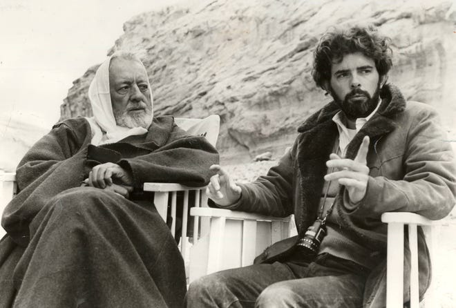 """On the set of """"Star Wars,"""" director George Lucas and Alec Guinness (Ben Kenobi) discuss Kenobi's mysterious appearance in the desert."""