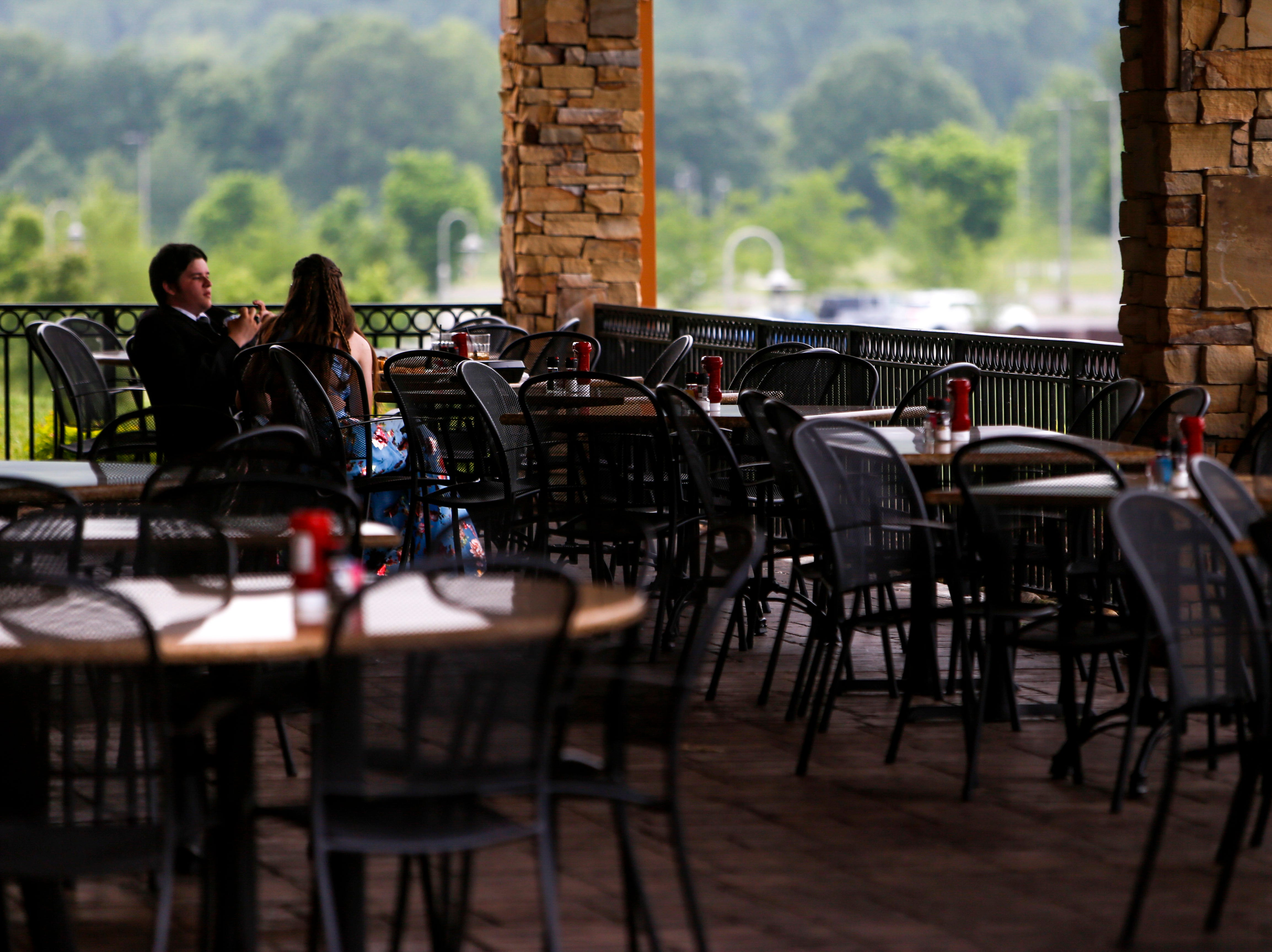 Two prom attendees have dinner at Liberty Park Grill before their night. Hundreds of seniors from Montgomery County Central High School celebrated their senior prom during a break from the weather in an otherwise rainy day at Wilma Rudolph Event Center in Clarksville, Tenn., on Saturday, May 11, 2019.