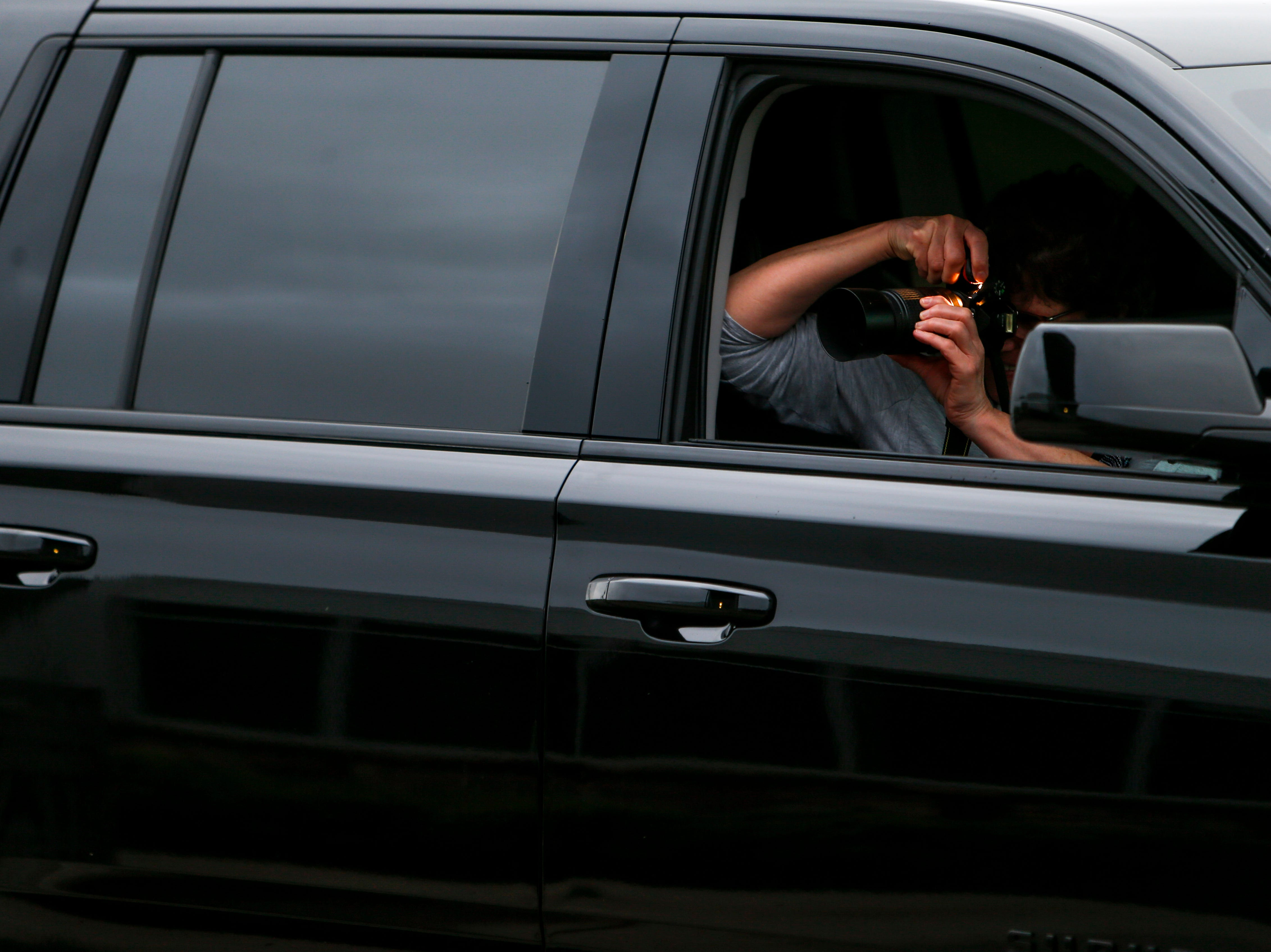 A parent peers out the window of their car to snap photos before hundreds of seniors from Montgomery County Central High School celebrated their senior prom during a break from the weather in an otherwise rainy day at Wilma Rudolph Event Center in Clarksville, Tenn., on Saturday, May 11, 2019.