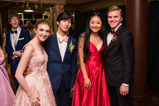 Linzi Moore, Kichul Kang, Mary Kim and Henry Ott at Rossview High School prom Saturday night at Valor Hall in Oak Grove, Ky.