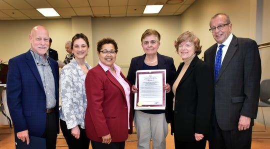 Union County Freeholder Chair Bette Jane Kowalski and Freeholders Rebecca Williams and Kimberly Palmieri-Mouded present a resolution to Dianne Spinelli congratulating her on being named the 2019 Linden Outstanding Senior Citizen of the Year during a ceremony at the John T. Gregorio Center in Linden. They were joined by Union County Surrogate James LaCorte and Assemblyman James Kennedy.