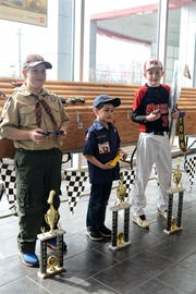 Pictured from left to right are the top three winners in the Grand Finals of the Pinewood Derby for theHunterdon Arrowhead District Boy Scouts of America: William Tyers (3rdplace), Evan Portela (2ndplace), and Jack Goodman (1stplace). Fred Beans Toyota of Flemington hosted the racing event, and the dealership provided all participating Scouts with patches and the winners with trophies.