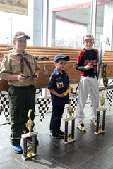 Pictured from left to right are the top three winners in the Grand Finals of the Pinewood Derby for the Hunterdon Arrowhead District Boy Scouts of America: William Tyers (3rd place), Evan Portela (2nd place), and Jack Goodman (1st place). Fred Beans Toyota of Flemington hosted the racing event, and the dealership provided all participating Scouts with patches and the winners with trophies.