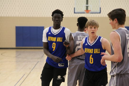 Class of 2023 prospect Omaha Biliew (9) will be a name to watch in Iowa high school basketball this year.