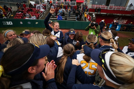 The Michigan softball team hugs and celebrates after defeating Minnesota to win the Big Ten softball tournament on Saturday, May 11, 2019, in Bloomington, Indiana.