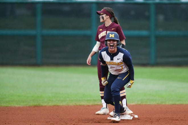 Michigan junior Madison Uden celebrates after hitting a double against Minnesota during the Big Ten softball championship game on Saturday, May 11, 2019 in Bloomington, Indiana.