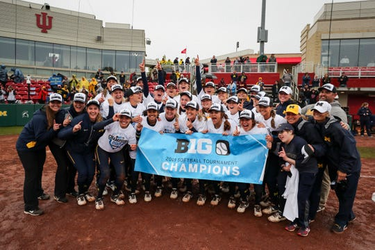 Michigan softball celebrates after winning the Big Ten softball tournament on Saturday, May 11, 2019.