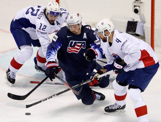 Antonin Manavian of France, right, battles Dylan Larkin of the U.S. during Sunday's game.