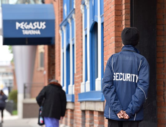 A security officer keeps a watchful eye outside the Greektown Casino.