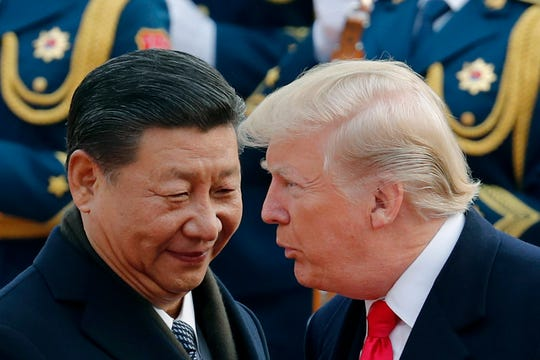 U.S. President Donald Trump chats with Chinese President Xi Jinping on Nov. 9, 2017, in Beijing. Talks in Washington broke off on Friday without a deal on trade, but both sides have indicated that future talks are likely.