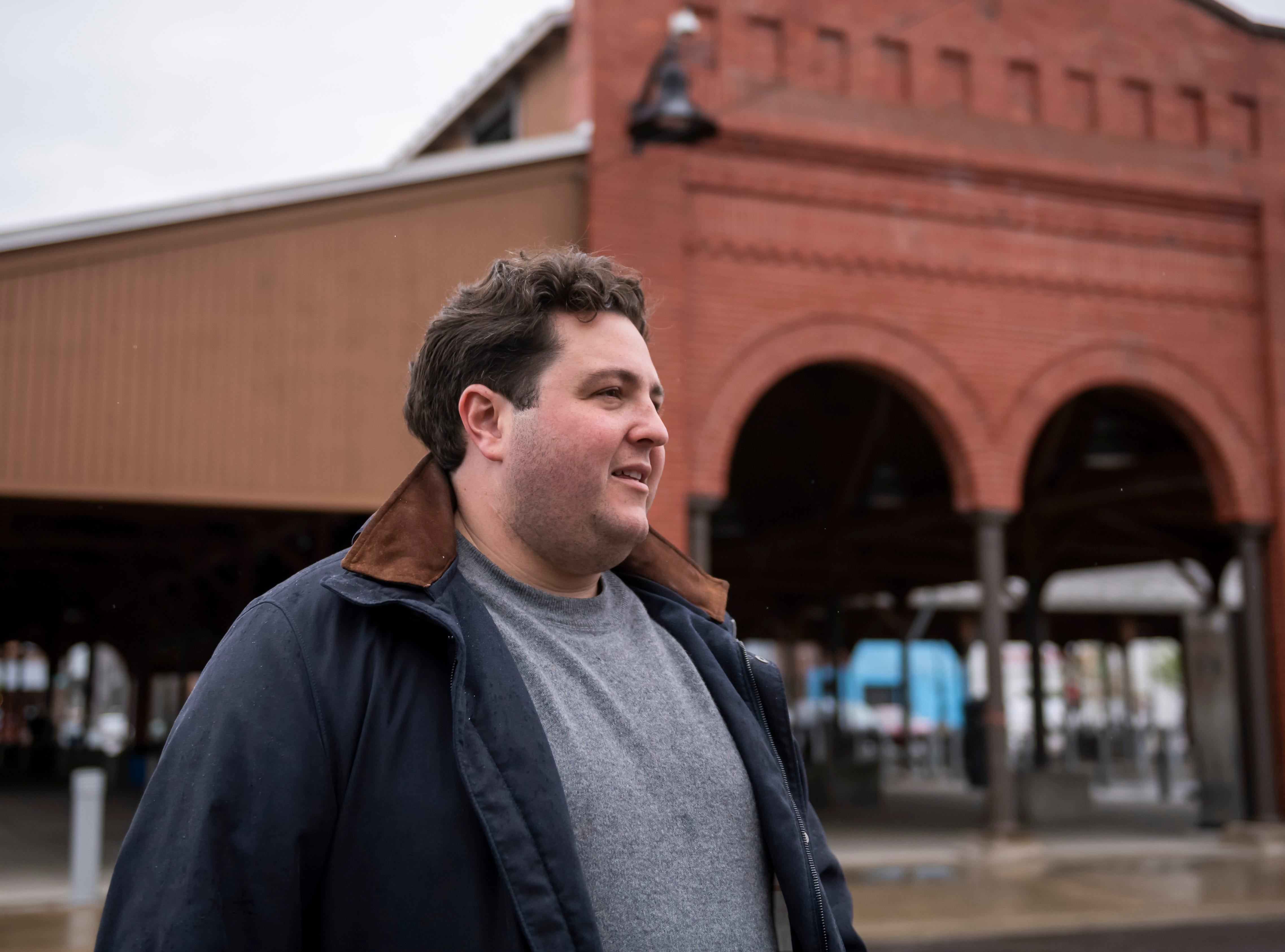 Sanford Nelson, President of Firm Real Estate, walks through Eastern Market, in Detroit, May 7, 2019.