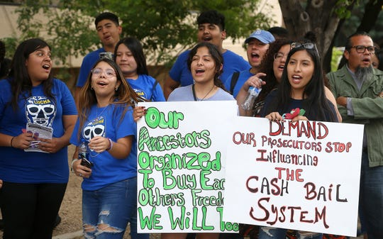 """Protesters gather in front of Maricopa County Attorney Bill Montgomery's office Thursday, May 9, 2019, in Phoenix. For Mother's Day, dozens of mothers are getting time with their children instead of time behind bars as the National Bail Out Collective is organizing its """"Black Mama's Bail Out"""" initiative to post bail for women of color who would otherwise be in jail. (AP Photo/Ross D. Franklin)"""