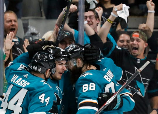 San Jose Sharks' Marc-Edouard Vlasic (44), Timo Meier (28) and Brent Burns (88) celebrate a goal by Meier against the St. Louis Blues in the second period in Game 1 Saturday. San Jose won 6-3.
