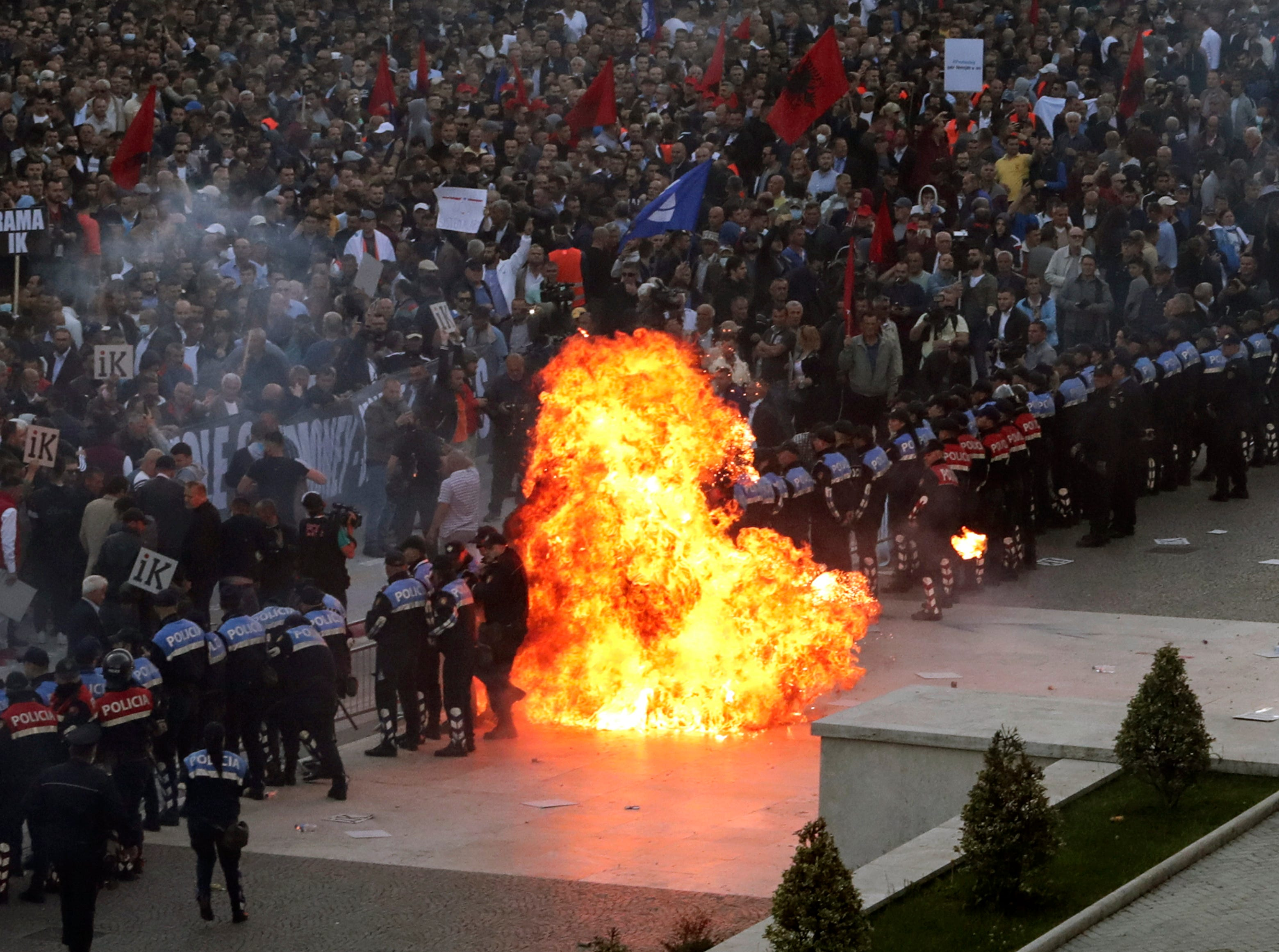 Flames from a petrol bomb thrown toward a police line blocking protesters taking part in an anti-government rally in Tirana, Saturday, May 11, 2019. Protesters demand the Socialist government to resign and call an early parliamentary election.