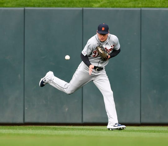 Detroit Tigers center fielder JaCoby Jones misjudges a hop on a ball hit by Minnesota Twins' C.J. Cron and the ball goes by him during the first inning.